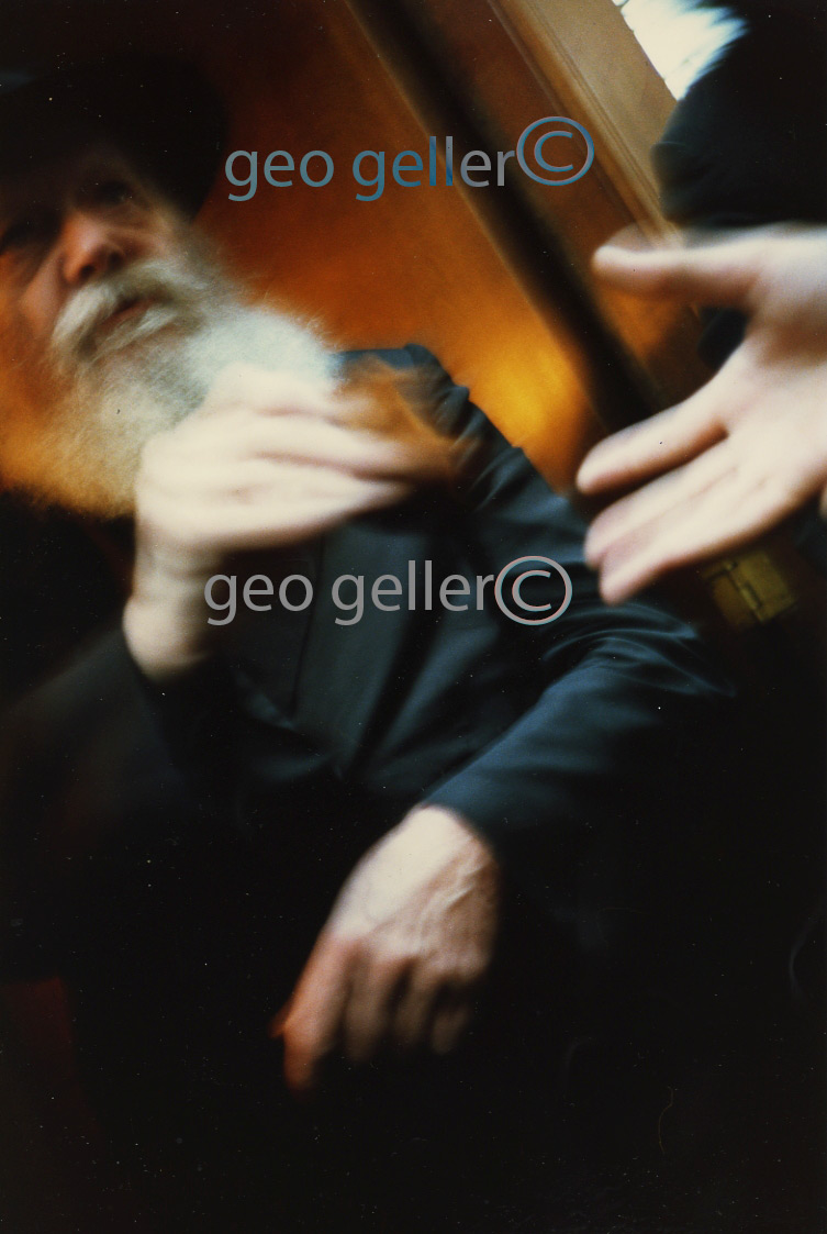 Giving: Rebbe-Schneerson - i took this photo in late 1980's - well actually the photo took itself and i recently discovered it - or maybe it discovered me - in  it's my hand reaching out and the Rebbe hand giving -